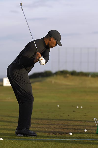 Marcus Allen warms up for his round on the Old Course.