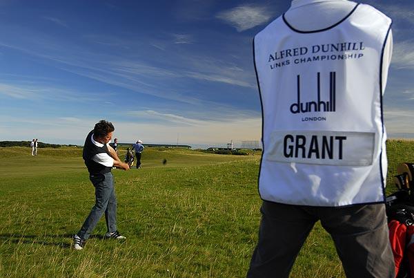 Actor Hugh Grant follows through on the Old Course.