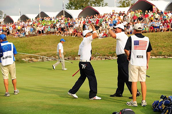 Mickelson and Kim birdied the last two holes for the win, 2 up.