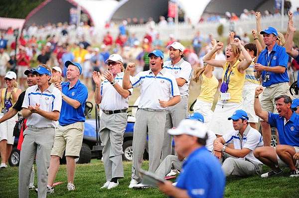 The European team gathered on the 18th green to watch their teammates Lee Westwood and Soren Hansen halve the final match of the day.