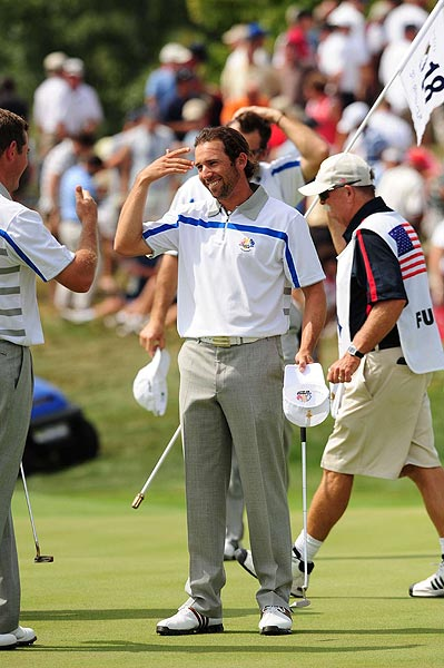 Garcia breathed a sigh of relief after he birdied the final hole to halve the match.
