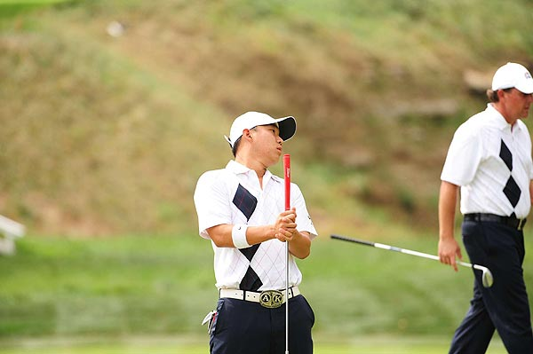 Anthony Kim, who was paired with Phil Mickelson twice on Friday, missed a short par putt on the second hole of their afternoon four-ball match.