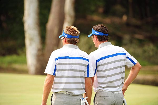 Europe's Ian Poulter and Justin Rose were 2 up at the turn over Steve Stricker and Ben Curtis.