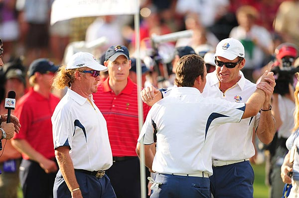 European team captain Nick Faldo was consoled by Sergio Garcia after it was over.