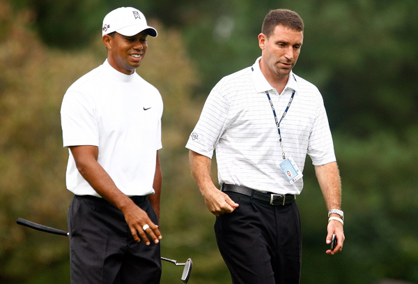 Woods' agent, Mark Steinberg, joined him for his practice round.
