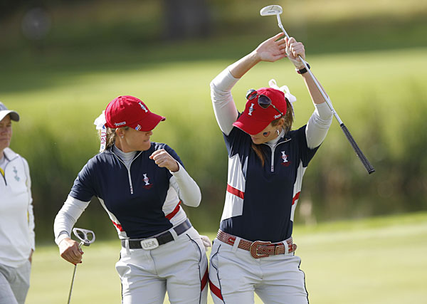 Kerr (left) and Paula Creamer halved their foursomes match on Saturday. But Kerr had to withdraw from her singles match on Sunday with tendonitis in her wrist, forfeiting a point to Karen Stupples of the European team. Kerr went 2-2-1 for the week.