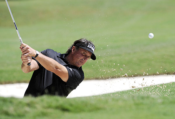 Phil Mickelson birdied three of the last five holes to move into contention.