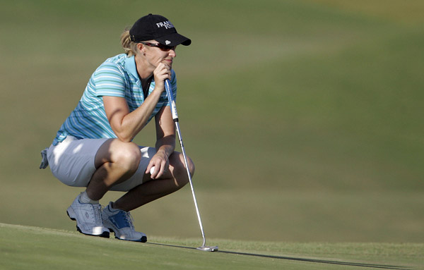 Janice Moodie birdied 18 to grab a one-shot lead.