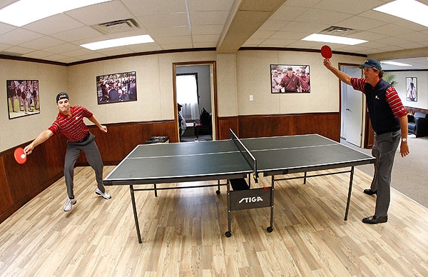 Before practice rounds on Wednesday, Phil Mickelson hit the Ping-Pong table with Zach Johnson.