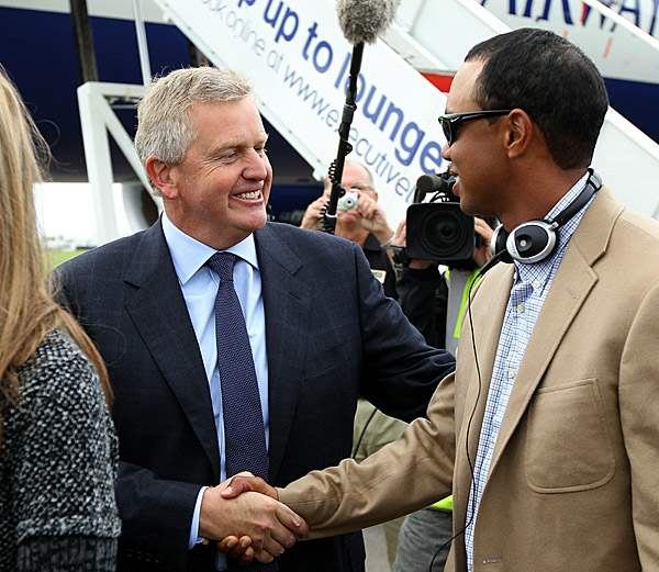 Colin Montgomerie, the European captain, was at the airport to welcome Tiger Woods and the rest of the U.S. players.