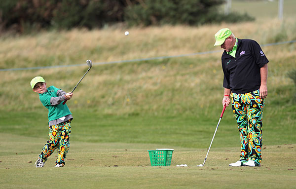 John Daly and his son worked on their games in matching pants.