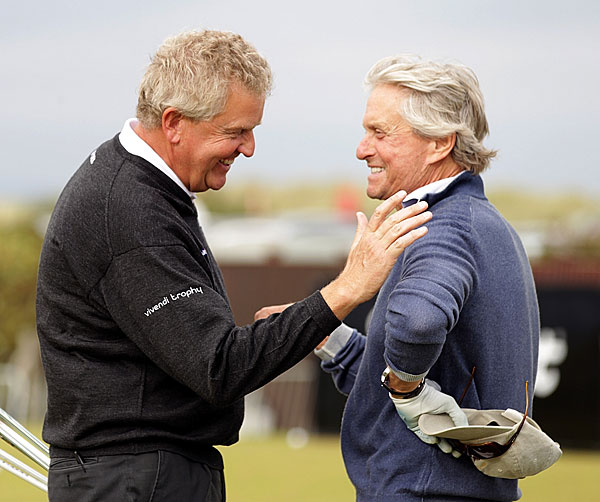 Michael Douglas and Colin Montgomerie shared a laugh Tuesday on the practice range.
