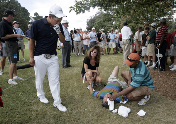 Kim only hit four fairways, and one of his errant tee shots hit a 48-year-old man in the forehead on the fly, opening a 2-inch gash. The fan, David Whitfield of Atlanta, was taken to a hospital but never lost consciousness and appeared to be in good spirits, according to the Associated Press.
