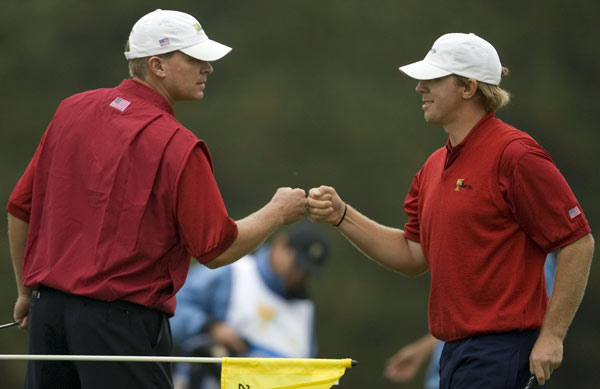 Steve Stricker, left, and Hunter Mahan grabbed the first point of the Presidents Cup with a 3&2 win over Geoff Ogilvy and Adam Scott.