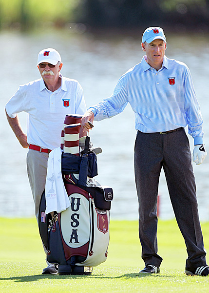 Furyk's caddie, Mike 'Fluff' Cowan, is caddying in his 10th Ryder Cup this year.