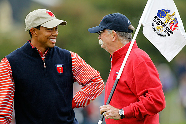 "Woods talked with Jim Furyk's caddie Mike ""Fluff"" Cowan on Thursday. Fluff toted Tiger's bag from 1996-1999."