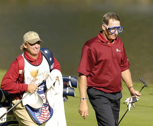 In a nod to his fall in the water Friday, Woody Austin sported a pair of goggles as he walked down the 14th fairway.