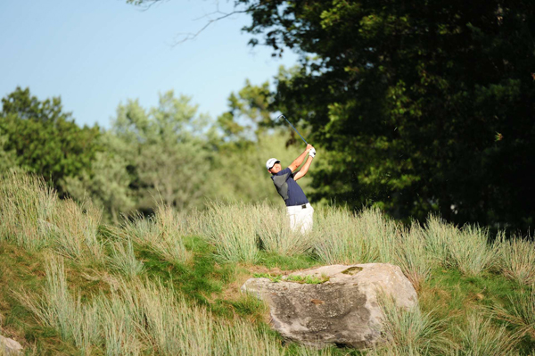 birdied the last two holes to grab a share of the lead.