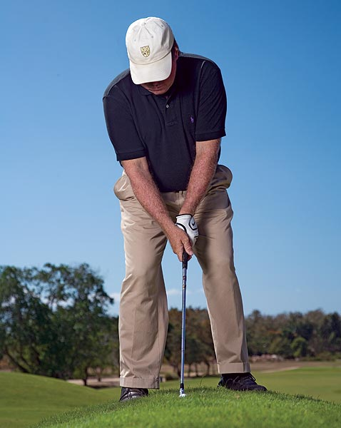 HOW TO PITCH IT CLOSE FROM LONG GRASS                                              STEP 1 Address the ball like normal and then stand back from it a little (feel like your hands are lower than usual and in a pre-cocked position). This adds bounce to the club (to help push it through the rough).                                              FINE-TUNE YOUR SETUP TO LAND IT CLOSE                                              The setup in Step 1 gives you the foundation to play multiple pitches. Add the tweaks below and you can get it close from anywhere.                                              1. To pitch it higher, play the ball between the center of your stance and your left foot.                                              2. To pitch it lower, play the ball between the center of your stance and your right foot.                                              3. To pitch it farther, widen your stance and stay square to the ball.                                              4. To pitch it shorter, choke down on the club and take an open, narrow stance.