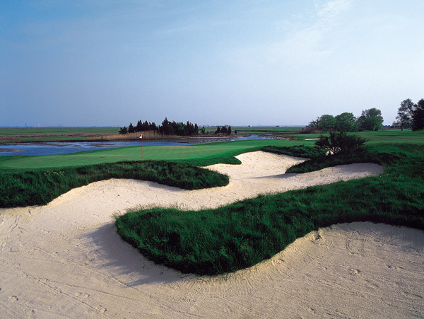 No. 99                       Atlantic City Country Club                                              What's old is new — at least for 111-year-old Atlantic City Country Club, which                       cracks our Top 100 You Can Play list for                       the first time. Originally laid out by John                       Reid and Willie Park Jr., ACCC was                       redesigned by William Flynn in 1923. But                       it was a Tom Doak redo in 1999 that made                       the difference. Measuring an Old World                       6,577 yards and playing to a par 70, the                       course eases across flat, firm coastal terrain.                       The 339-yard, par-4 14th perfectly                       illuminates the course's virtues, with its                       peninsula tee, bunkers and marshes and                       its view of the Atlantic City skyline.
