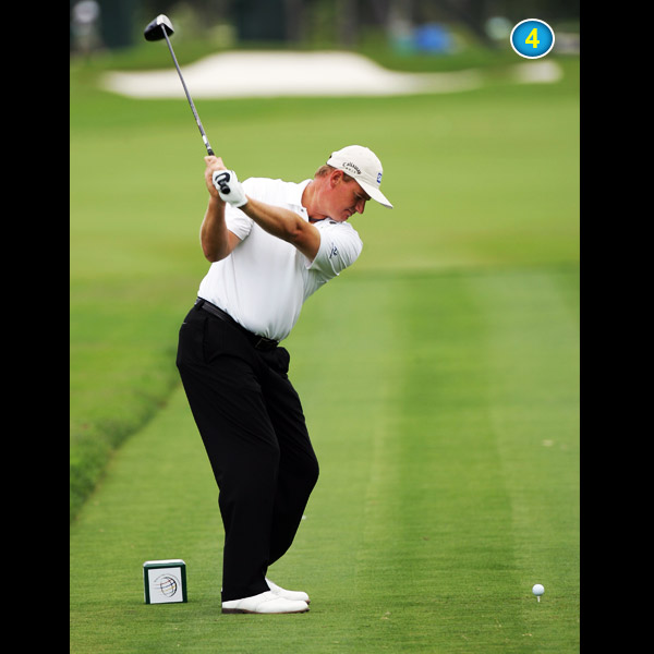 You can really see the bend in Ernie's right elbow. Most golfers confuse a bent right arm with a smaller swing arc, but this move actually creates width and extra power.