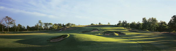No. 27                       Erin Hills Golf Course                                              The most talked about course of 2006                       is, like Chambers Bay, a wild Irish rover                       that unfolds over heaving farmland 35                       miles northwest of Milwaukee.                                               Already                       named as the site of the 2011 U.S. Amateur,                       this Michael Hurdzan/Dana Fry/Ron                       Whitten design remains on the short list                       of possible U.S. Open venues.                                               Stretching                       7,824 yards from the back, Erin Hills has                       all the length it will ever need, plus an endless                       variety of lies, stances and angles. Only                       the club's bratwurst reminds you that the                       Emerald Isle is still an ocean away.