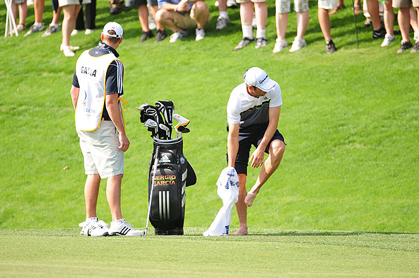Sergio Garcia was forced to hit out of the water on the 18th hole and went on to triple bogey. He's at one under.