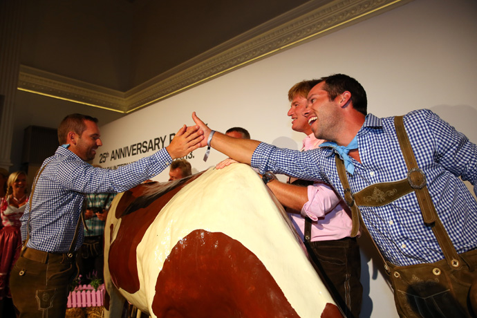 Sergio Garcia, left, was congratulated by Casey after milking the cow.