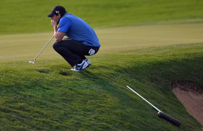 Rory McIlroy looks on at the edge of the 17th green during the third round of the BMW Shanghai Masters. Coming off a second-place finish at the Korean Open, McIlroy finished T27.