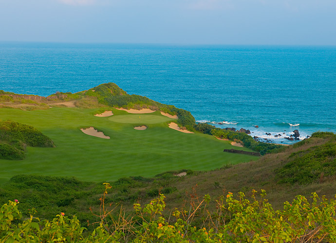 Shanqin Bay, No. 78 World                       This year-old Coore/Crenshaw design unfolds atop a sprawling, sloping bluff that overlooks the South China Sea. A departure from China's usual preference for straight-forward shot requirements, lush conditions and sharp edges, Shanqin Bay offers firm and fast fairways, tattered-edge bunkers and a couple of blind shots.