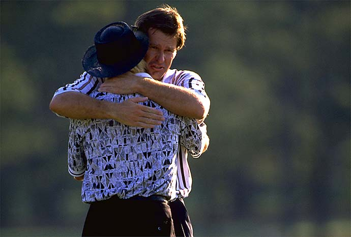 SI's Michael Bamberger called this hug at the 1986 Masters, when Nick Faldo comforted Greg Norman after Norman's stunning collapse, one of the greatest Masters moments ever.