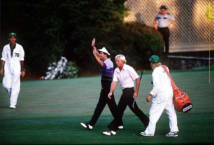 Gracious again in defeat, Greg Norman walk off the green with Larry Mize after Mize won their playoff round during the 1987 Masters.