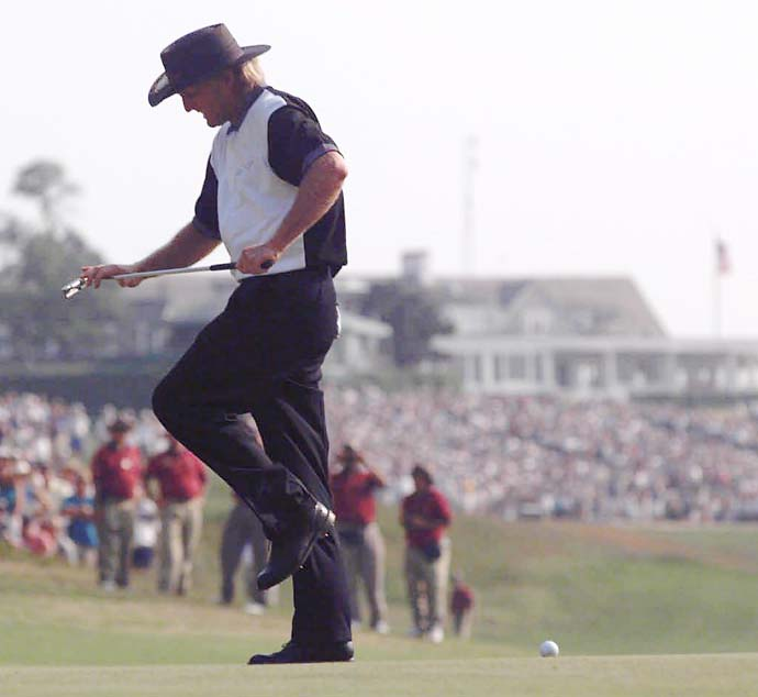 Greg Norman acts like he is going to break his putter over his knee in disgust after missing a key putt for a birdie on the 14th hole during the final round of the 95th U.S. Open at the Shinnecock Hills Golf Club in Southampton, N.Y., Sunday, June 18, 1995.