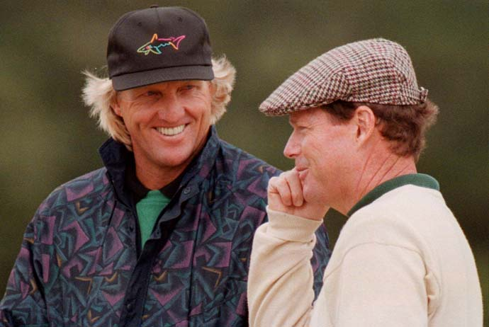 Greg Norman shares a laugh with Tom Watson on the 2nd tee of the first round of the 1995 British Open at St. Andrews.