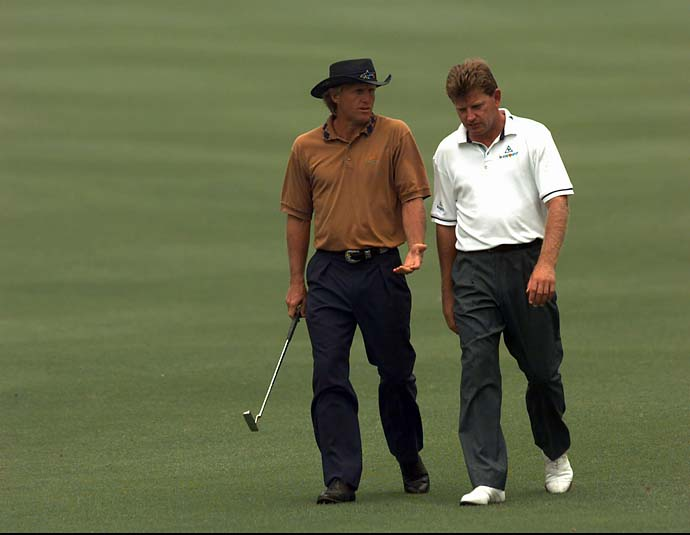 Greg Norman and Nick Price talk as they walk along a fairway at the Riviera Country Club in Los Angeles, Wednesday, Aug. 9, 1995, during a practice round for the PGA Championship.