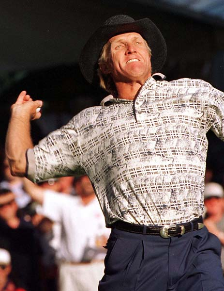 Greg Norman throws his ball into the crowd in celebration after winning his fifth Australian Open in November 1996.