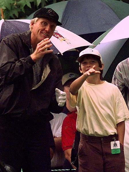 Greg Norman and his son Gregory Jr. have a chat before Norman tees at the 4th tee at Winged Foot Golf Club in Mamaroneck, N.Y., on August 13, 1997, prior to the PGA Championship.