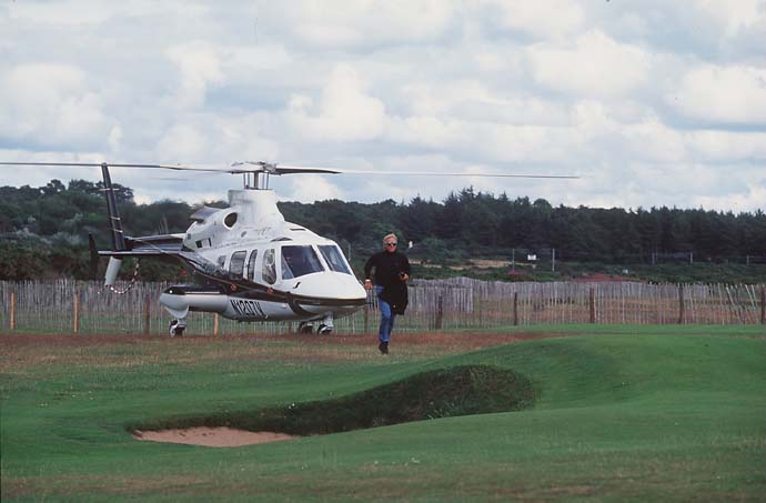 Greg Norman arrives by helicopter at the 126th Open golf championship at Royal Troon Golf Club, Scotland.