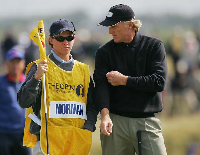 Greg Norman with his son Gregory caddying for him on the eighth green during the second round of the 133rd Open Championship at the Royal Troon Golf Club on July 16, 2004 in Troon, Scotland.