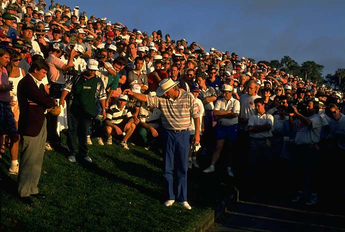 Alone in a crowd: Greg Norman takes a drop at TPC Sawgrass in the 1994 Players Championship. Norman won the event by four strokes.
