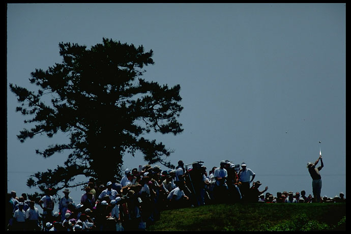 Dramatic shot of Greg Norman on the tee at dusk in Shinnecock at the 1995 U.S. Open. Norman finished second to Corey Pavin.