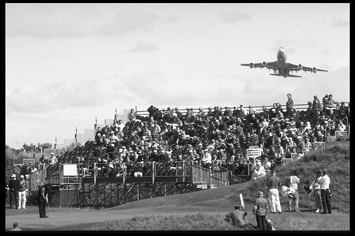Greg Norman putts as a jet passes over Royal Troon from nearby Prestwick Airport at the 1997 British Open.