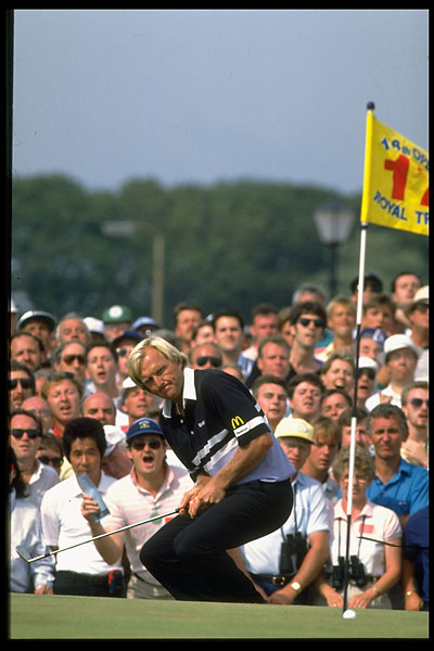 Greg Norman crouches down as he watches a chip-in at 1989 British Open at Royal Troon.