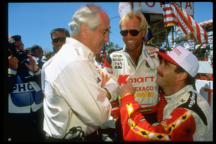Roger Penske, Greg Norman and Nigel Mansell victorious after the Long Beach Grand Prix race on April 15, 1993