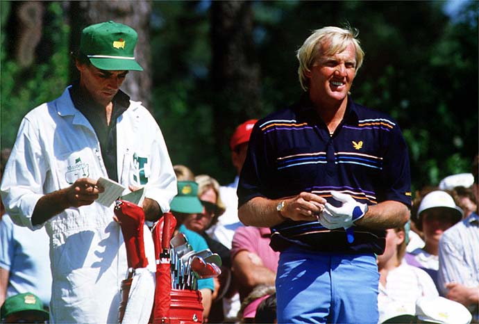 Greg Norman with his caddie during the 1986 Masters.