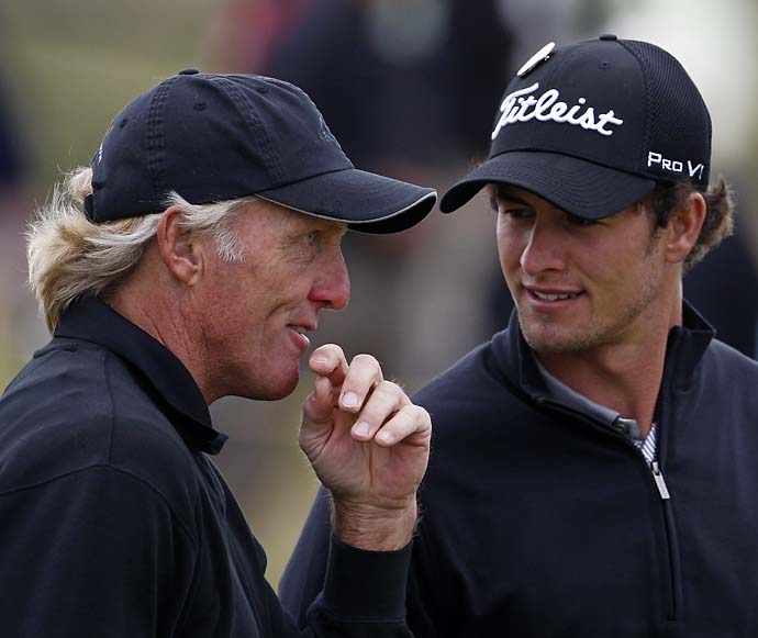 Greg Norman talks with compatriot Adam Scott as they practice on the 2nd during the third practice day at the British Open at Royal Birkdale in Southport in northwest England, on July 16, 2008.