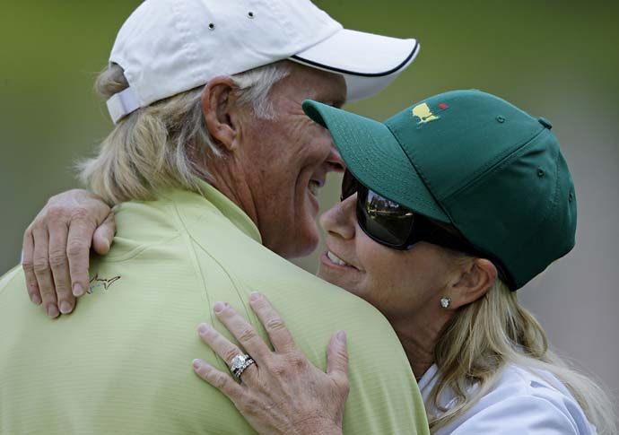 Former tennis champion Chris Evert hugs then husband Greg Norman following the Par 3 Contest before the Masters golf tournament at the Augusta National Golf Club in Augusta, Ga., Wednesday, April 8, 2009.