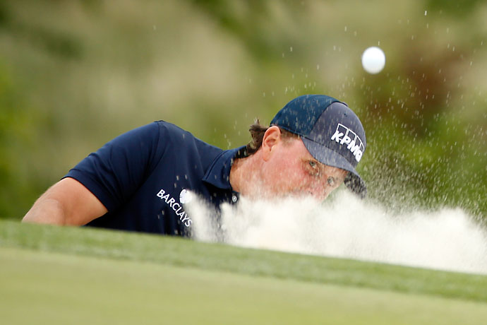 Phil Mickelson hits his ball out of the bunker on 17th hole during the third round of the Shell Houston Open on Saturday.
