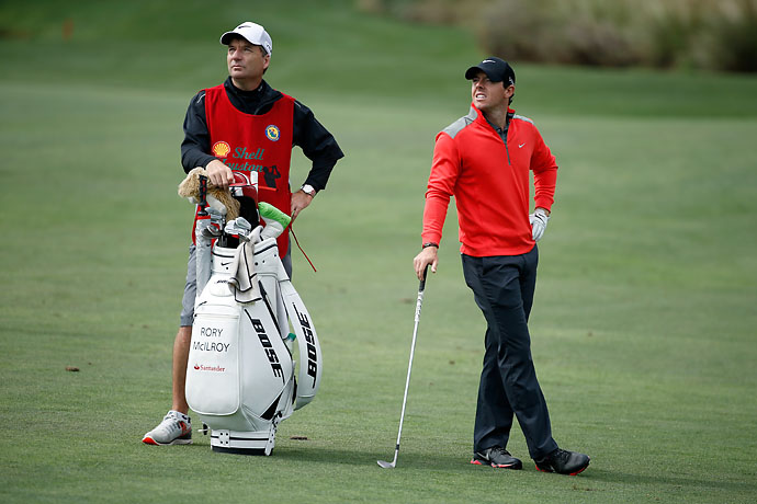 Rory McIlroy stands with his caddy J.P. Fitzgerald on the 12th hole fairway during round three of the Shell Houston Open.