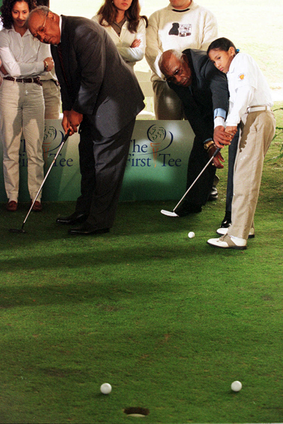 Sifford, right, and Earl Woods helped open an inner-city junior golf program in Houston in 1997.